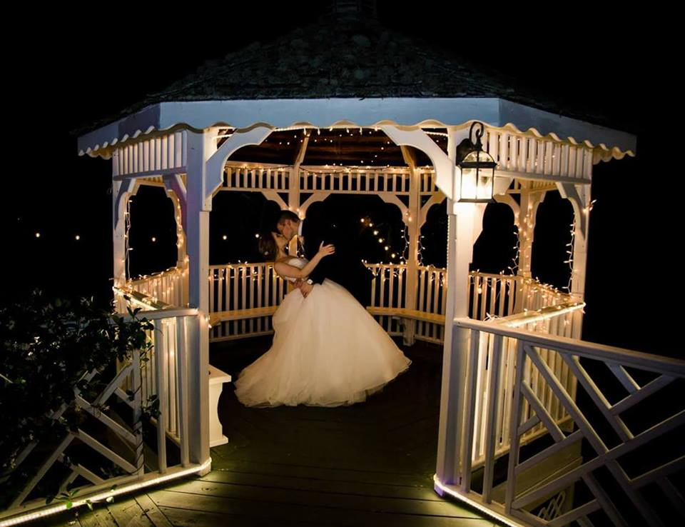 gazebo kiss at the grand magnolia house.jpg