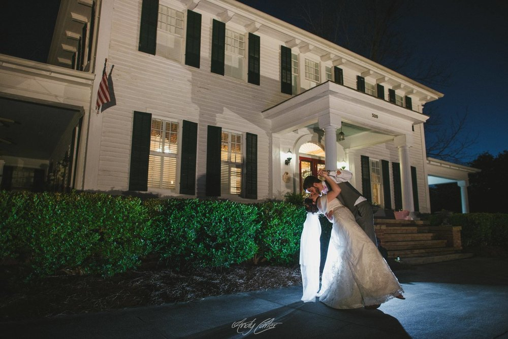kiss the bride at the grand magnolia house.jpg