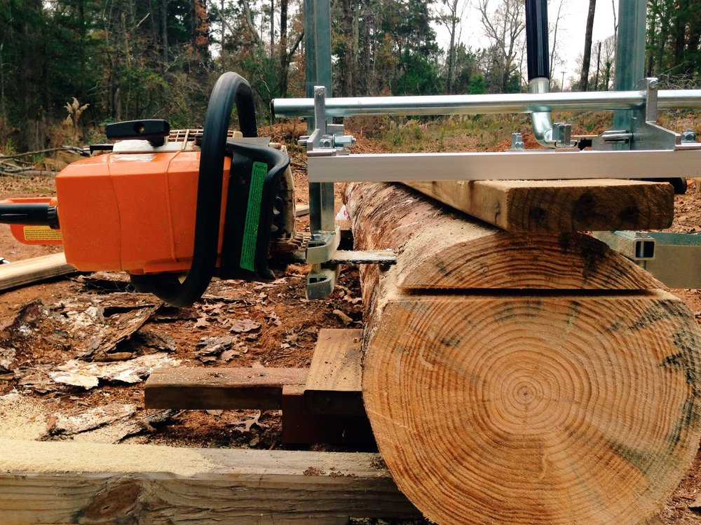 An Alaskan saw mill works by providing a fixed cut depth and a rail on which to run a chainsaw down the length of a fallen log.