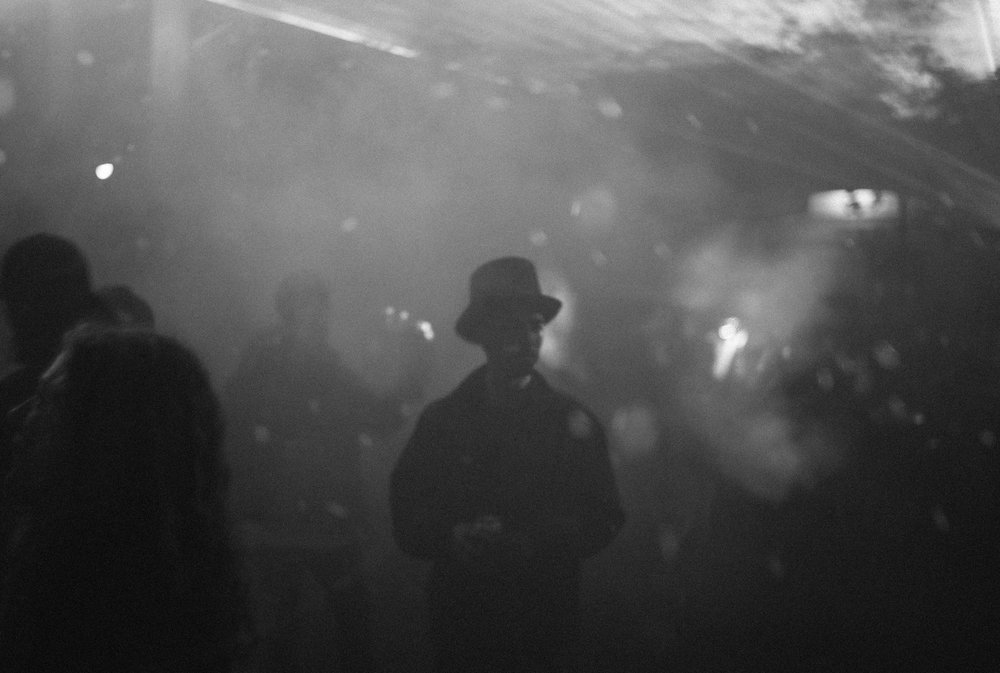 Guy with hat at techno party