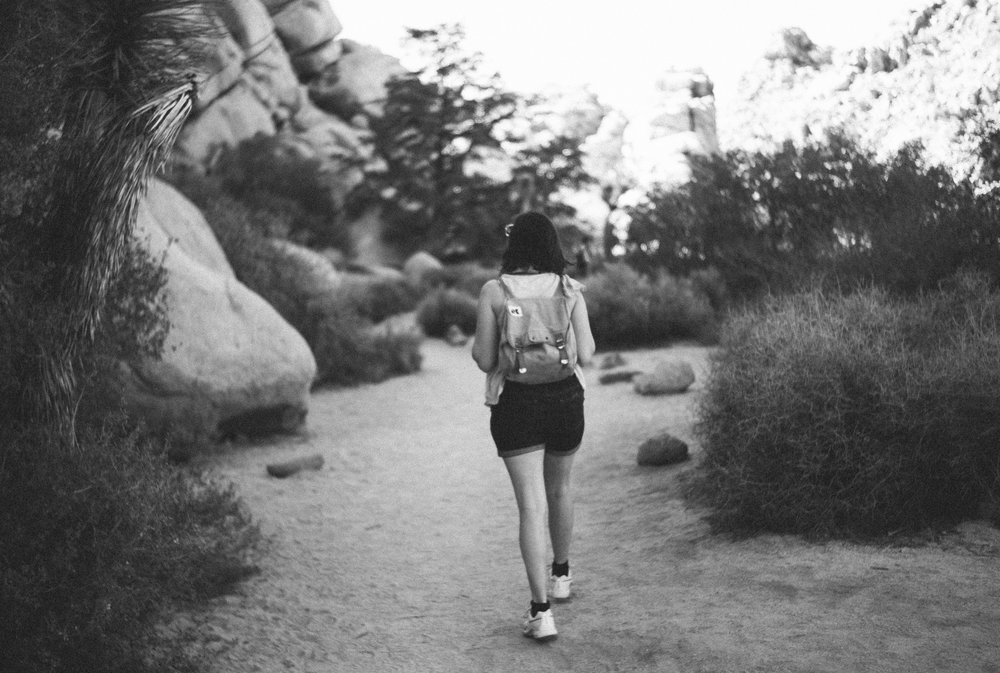 Girl with backpack walking