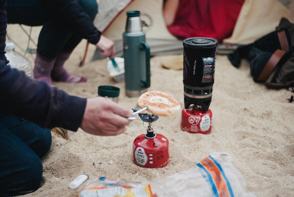 Cooking bagels with camping stove