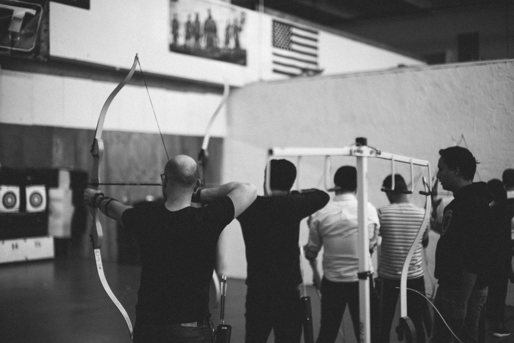 Uber employees at the archery range