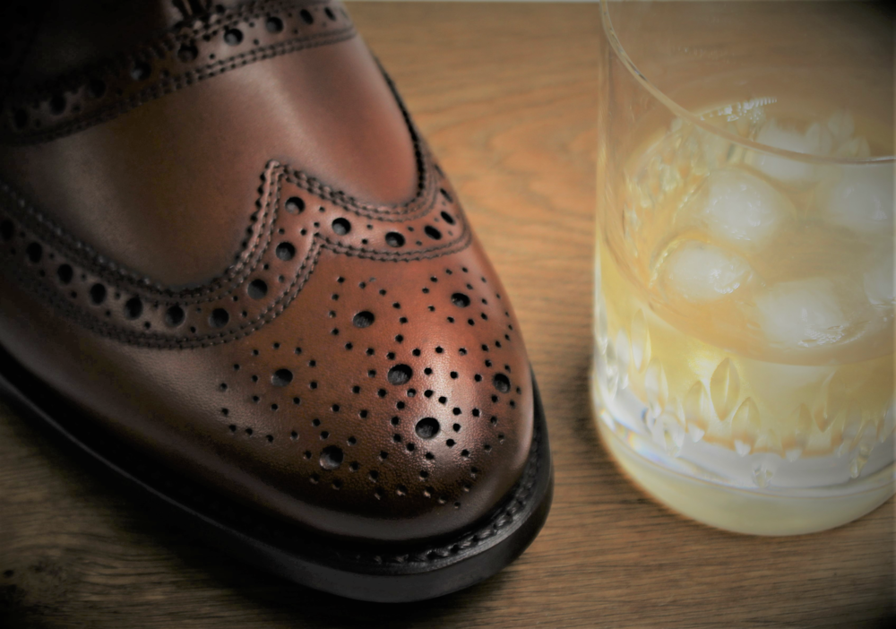 Detail - A meticulous proclivity for the finer things in life - A good fit - the feel of leather - a dram of scotch