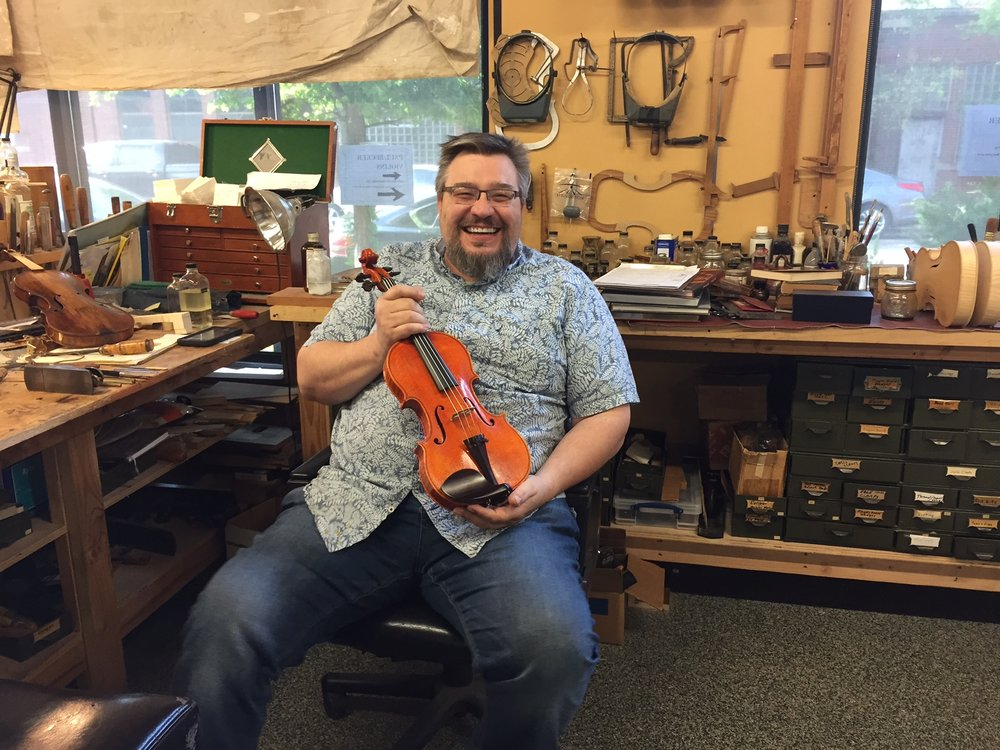 Paul holding a Strad Model Paul Becker Shop Instrument