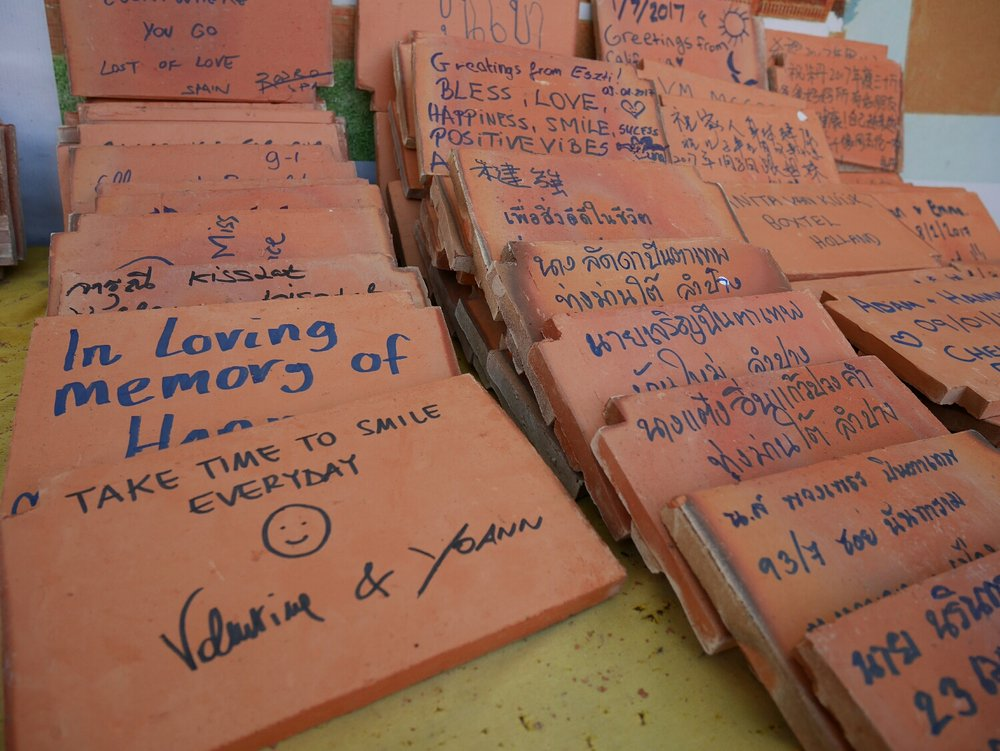New Year vows written on tiles that will be used to build a new temple...can you spot mine? :)