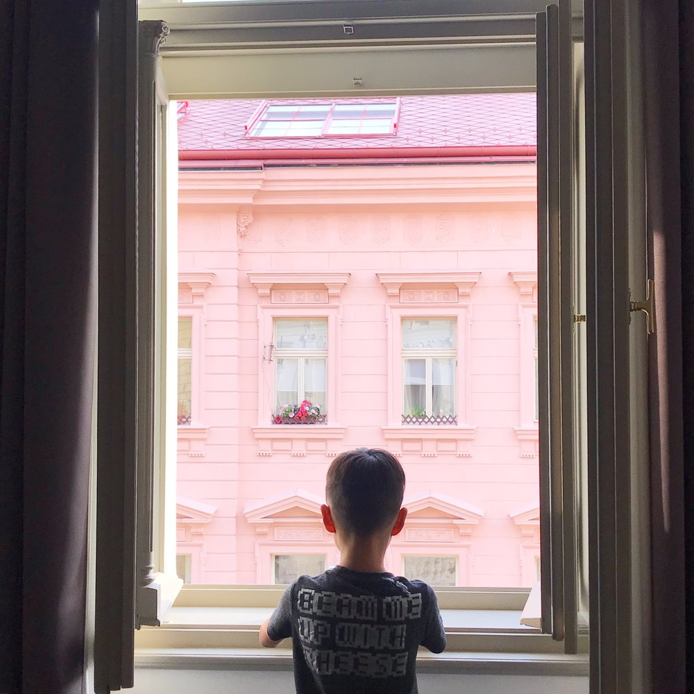 """Our very first impression of Praha was best put by big Tru- """"It's like a big Ladurée box! All the building look like sweet treats. """" This was our view from our  hotel  , how perfect is that pink!"""