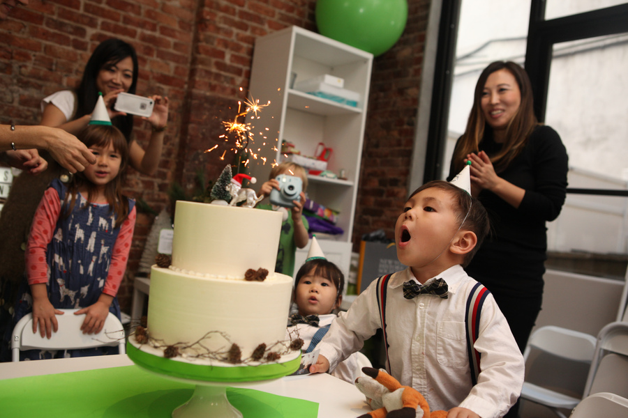 I love Olive's surprised expression! It was the first time the kids saw a sparkler candle!