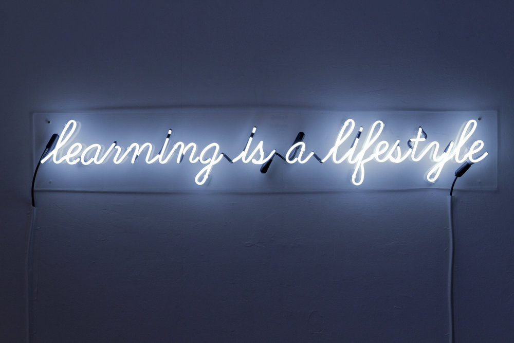 """Learning Is A Lifestyle"" neon piece by Edyta Stepien inspired by a phrase from Brother Mike Hawkins."
