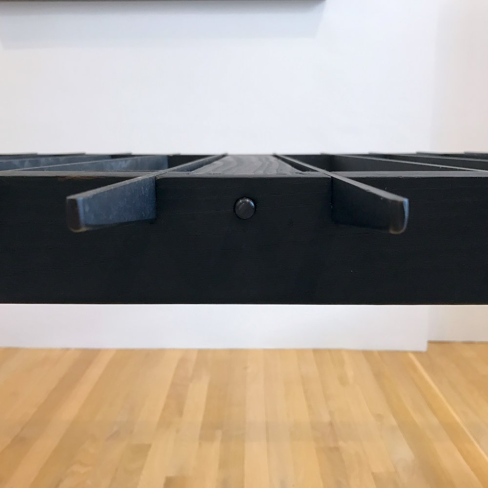 blackened steel and charred ash dining table detail