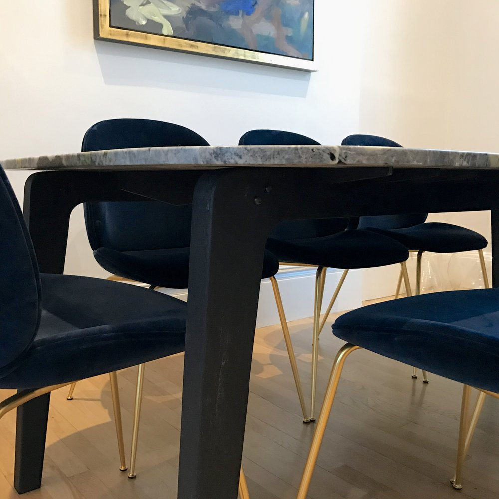 bespoke charred ash, steel and marble dining table leg detail