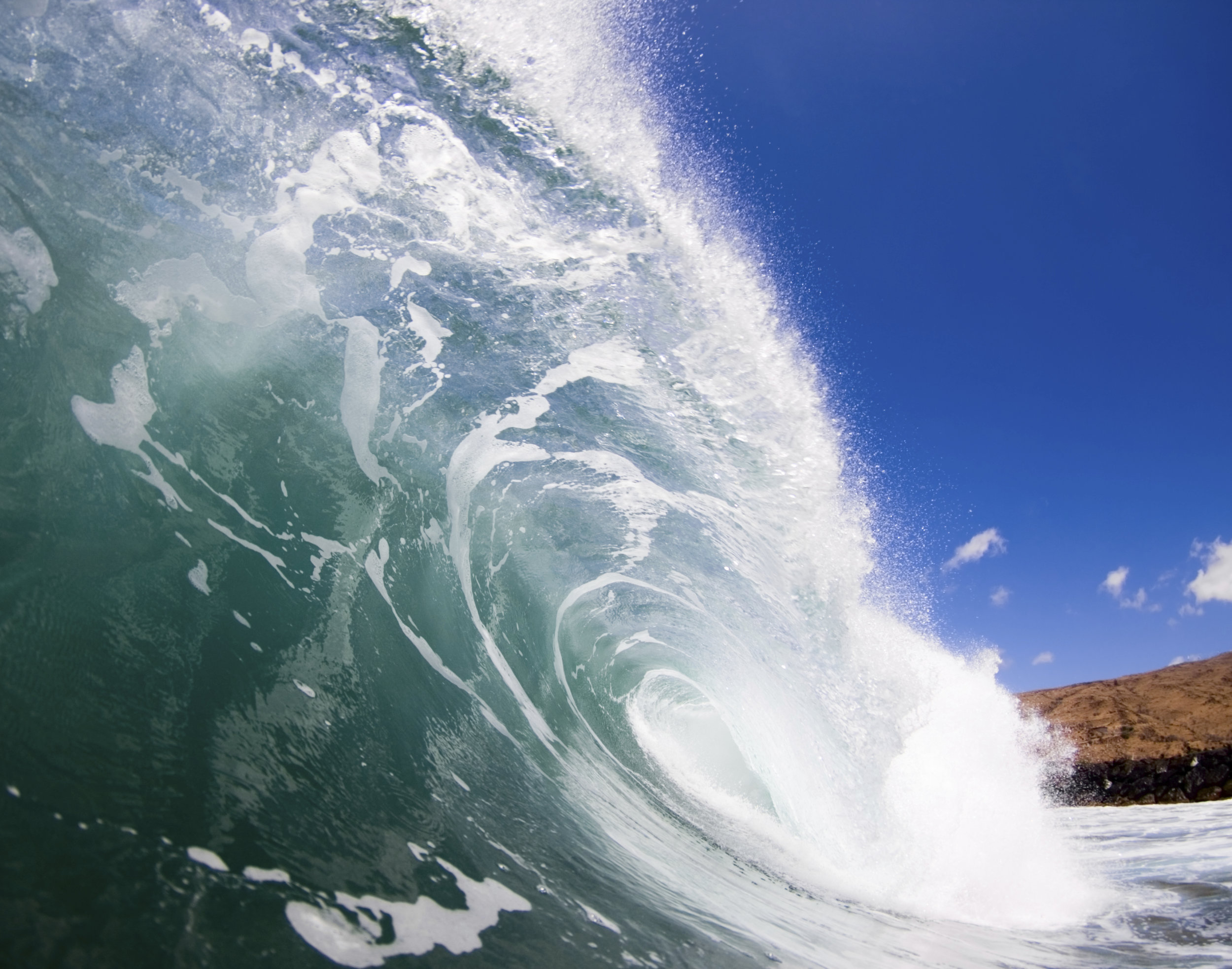 In the barrel of a perfect wave.