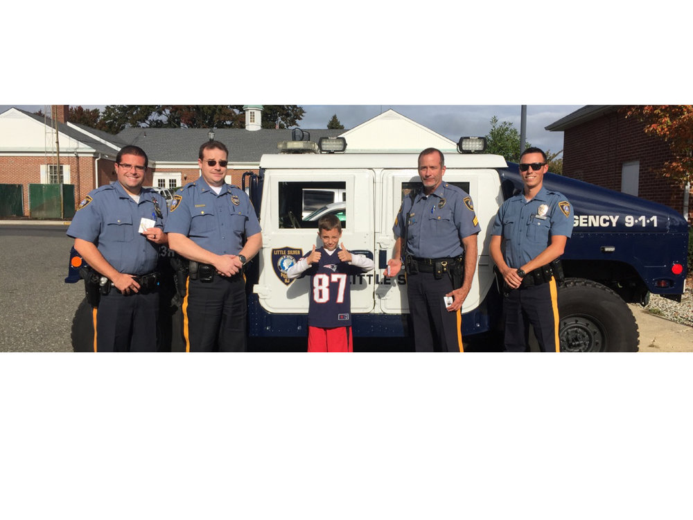 Maxwell visiting with officers in the Little Silver NJ Police Department in support of Behind the Blue