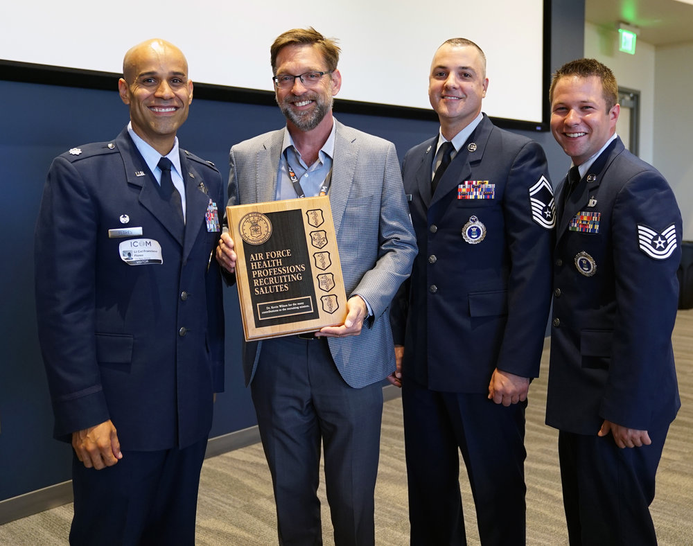 (L-R) Lt. Col. Francisco Flores, Dr. Kevin Wilson, SMSgt. Johann Lynch, and TSgt. Edward Rohde