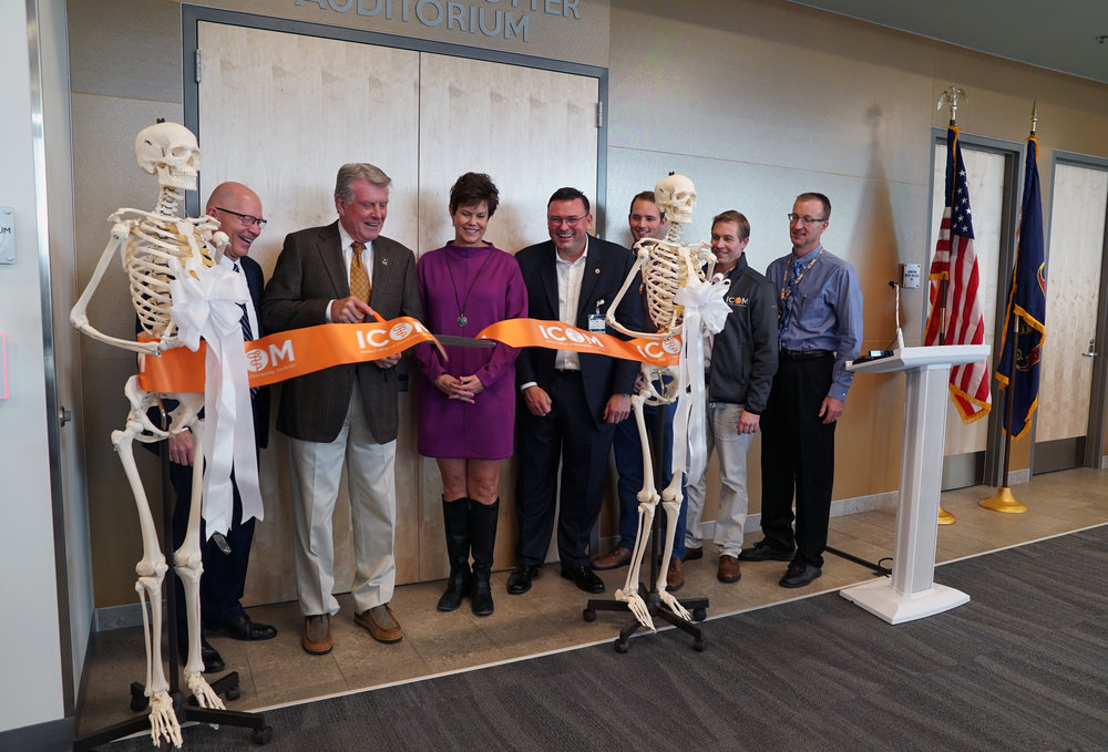 "Gov. C.L. ""Butch"" Otter cuts the ribbon on his namesake auditorium. (L-R) ICOM President Dr. Tracy Farnsworth; Gov. Otter; First Lady Lori Otter; ICOM Dean Dr. Robert Hasty; ICOM Student Doctor Jacob Boyd; ICOM Professor Dr. Dennis Rau; ICOM Professor Dr. Rodney Bates."