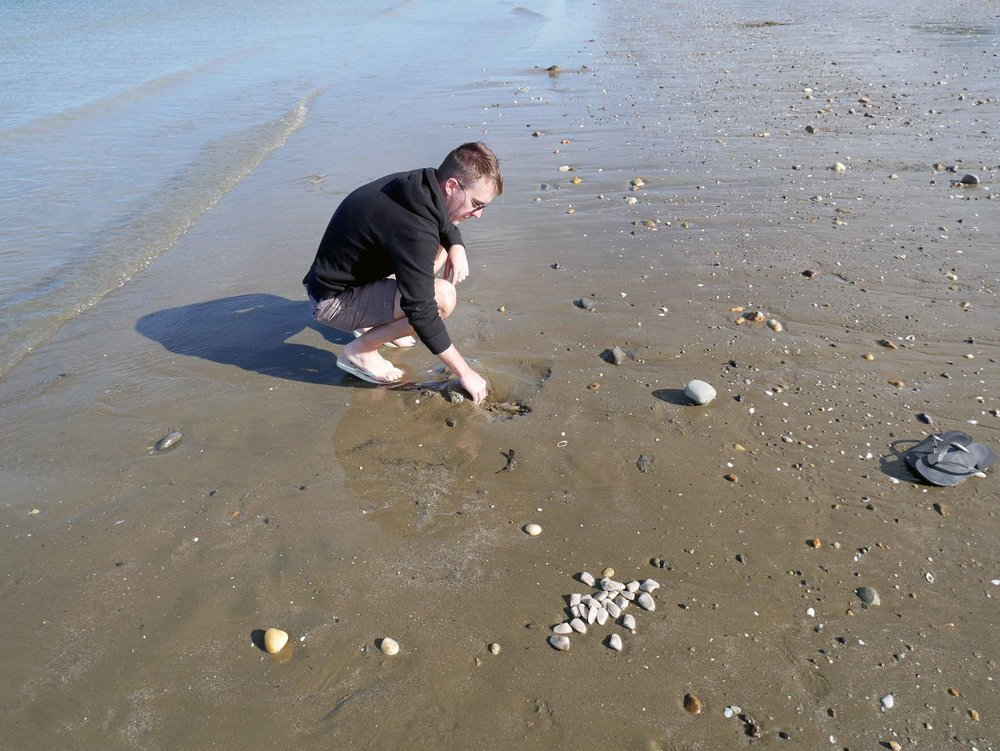 Trey digs for dinner, not hard when the beach is exposed during low tide.