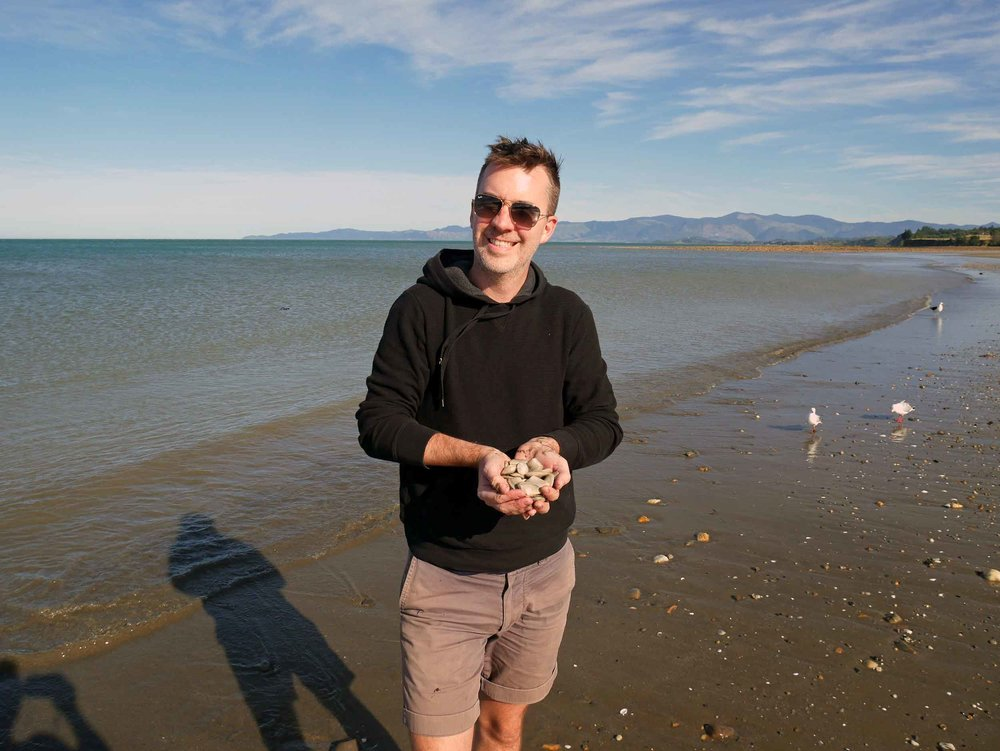 Trey shows off our dinner finds from the shoreline of Parapara Beach (Golden Bay; Jan 13).