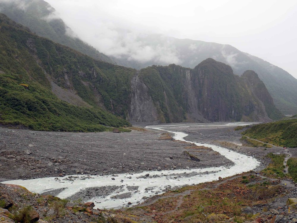 The outflow of Fox Glacier forms the Fox River that runs through the glacier valley to the coast (Jan 6).