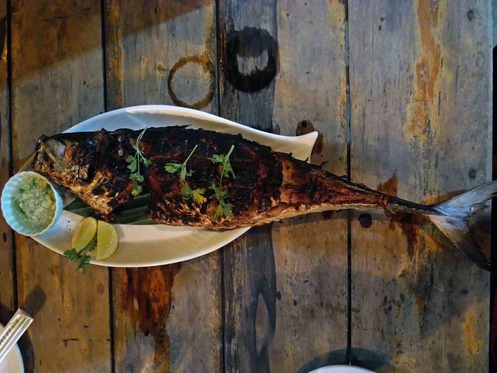 Tasty whole BBQ grilled fish served with steamed veggies at Ume Restaurant.