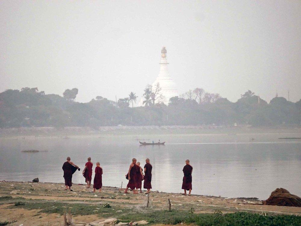 Playful monks pass a rattan ball beside the shore of U-Bein (Feb 18).