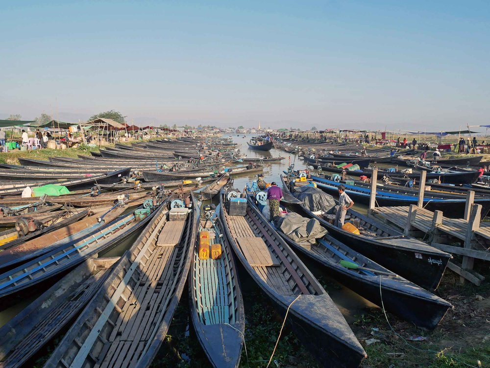 The local market shifts daily from village to village with many boats parked along its edge (Feb 22).