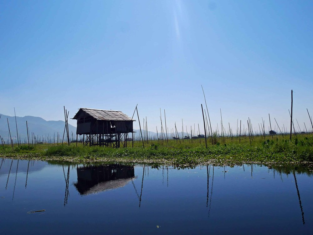 The stilted bamboo thatch homes along Inle Lake offer protection and shade from the hot sun (Feb 22).