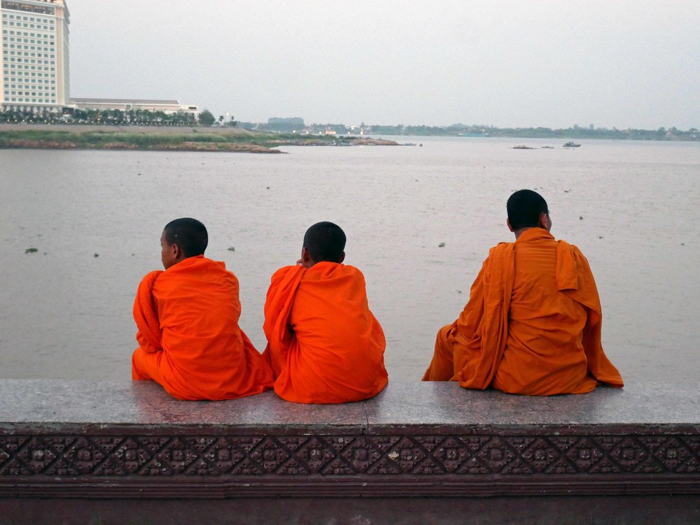 Young monks resting on the shore of the Tonle Sap River, which joins the Mekong in Phnom Penh (March 10).