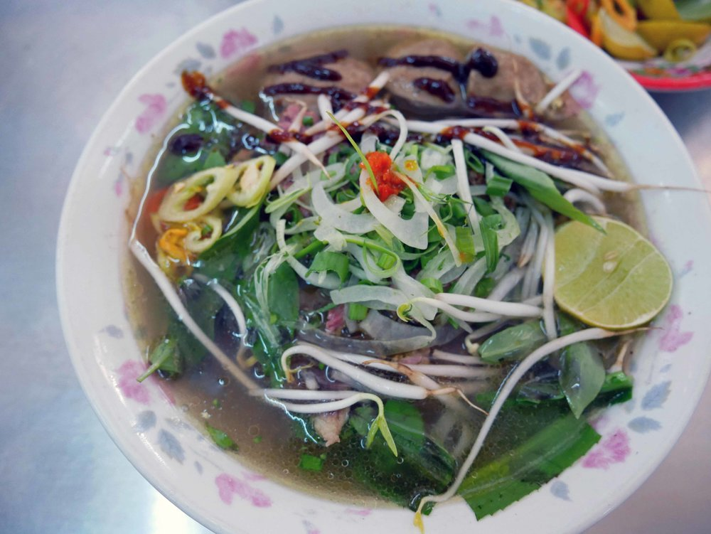 We couldn't get enough of the sweet and spicy Pho beef broth, full of herbs, scallions, and red chilis.