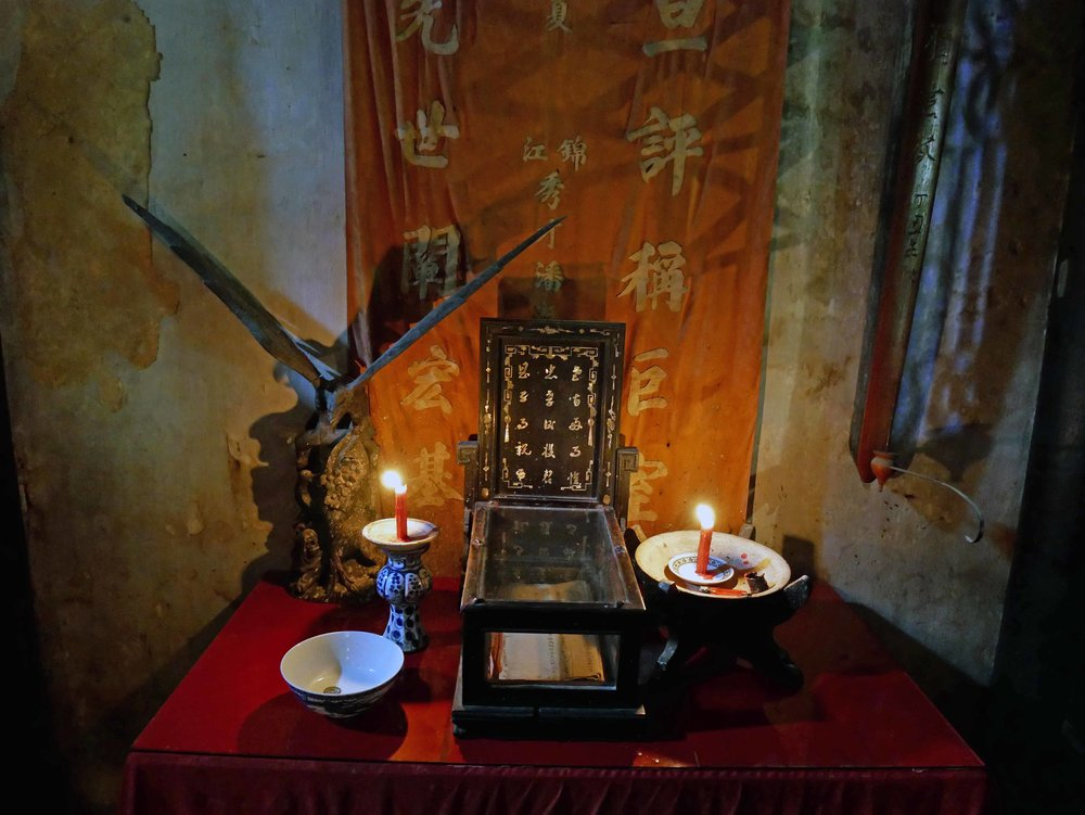 The alter in Tran Family Chapel for offerings, incense burning and lucky coins.