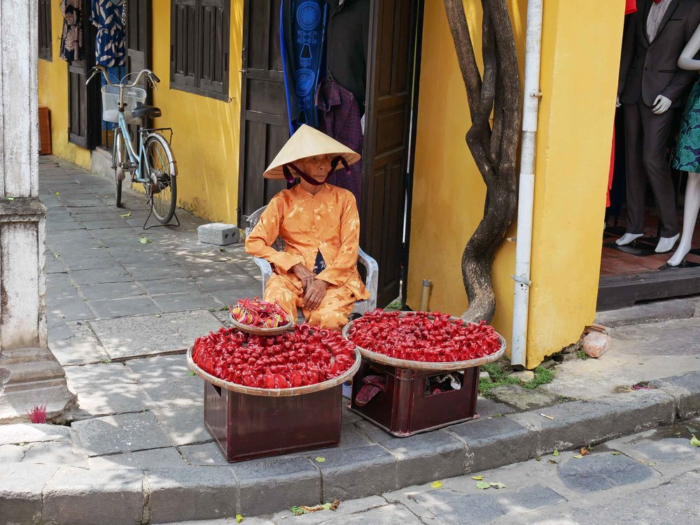 Vietnamese ladies line the small lanes through the Ancient Town selling souvenirs and gifts.