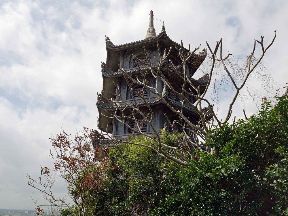 On Marble Mountain, the towering Xa Loi Pagoda overlooks the coast of the East Vietnam Sea.