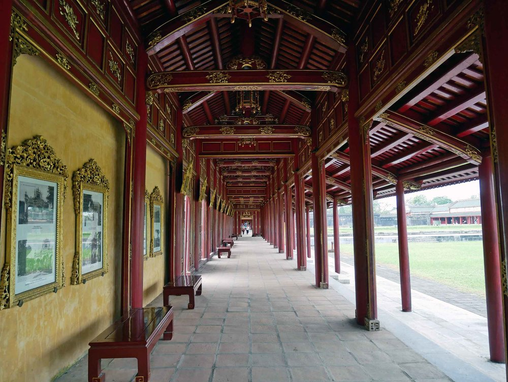 "One of several ""long corridors"" within the Imperial City, now lined with history and photographs of the complex."