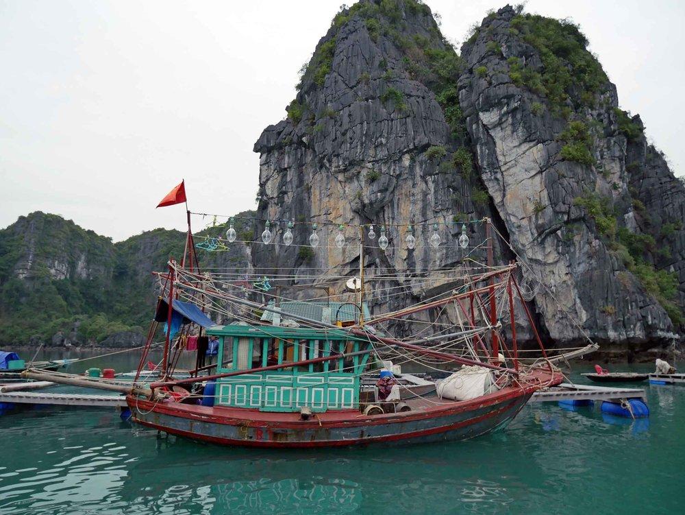 A beautiful, ornate fishing boat docked at Cuan Van floating village in Halong Bay (Mar 27).