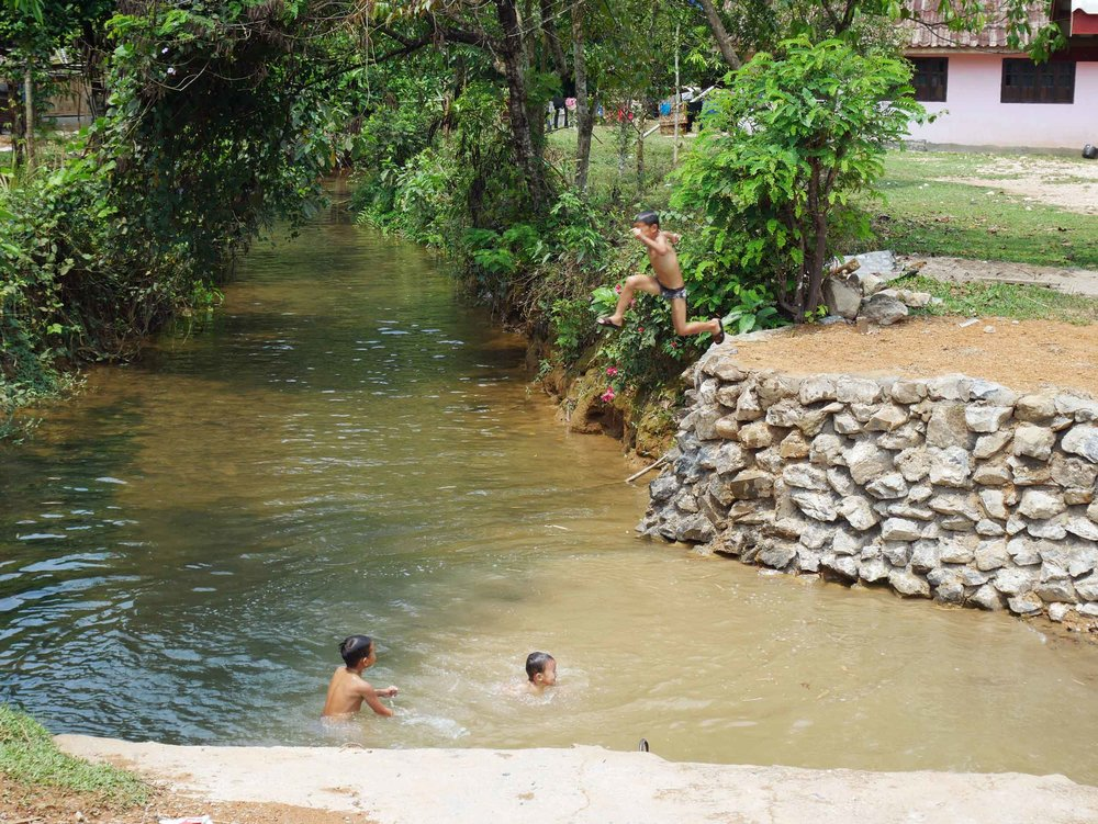 As we rode along the winding roads, we saw local children splashing in streams, while adults lounged in hammocks and under the shade of small porches--it was a Sunday after all!