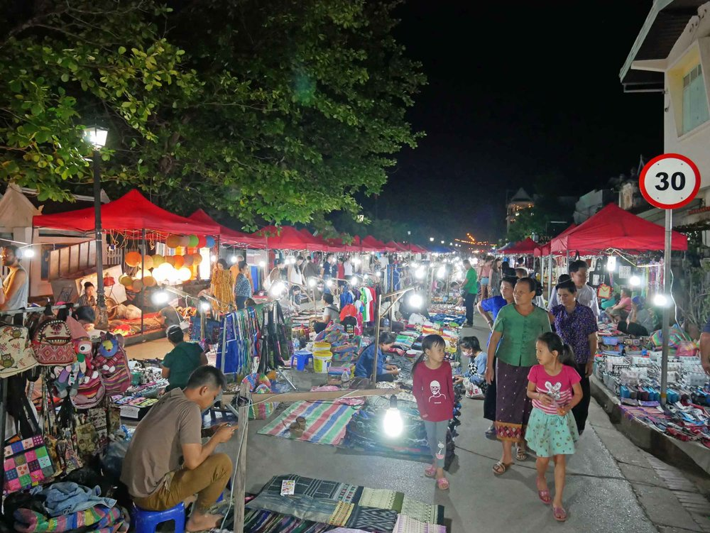 The bustling, crowded night market in Luang Prabang was full of activity and tourist treats.
