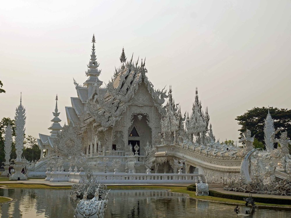 The glistening White Temple, or Wat Rong Khun, was only built in 1996 by local Chiang Rai artist Chalermchai Kositpipat