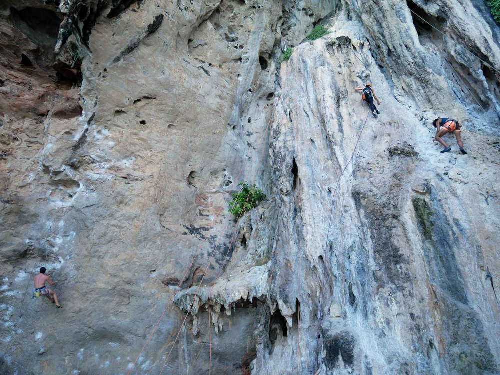 Another sight to behold on Railay is the tourists climbing up the limestone karsts.
