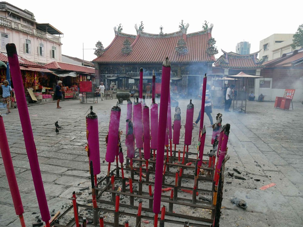 "Also located on the ""Street of Harmony,"" giant sticks of incense burned outside Goddess of Mercy Temple, a Taoist temple built in the early 1700s."