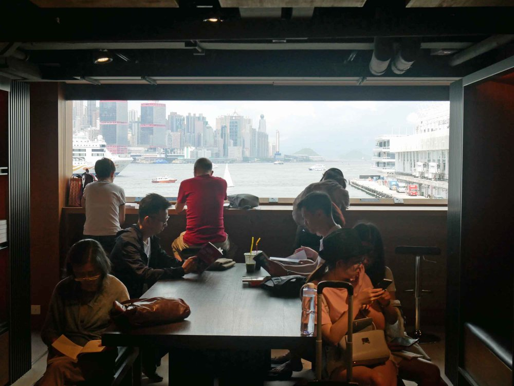 Throughout the multi-level bookstore, there are many places to sit and enjoy a book or periodical with commanding views of Hong Kong Island.
