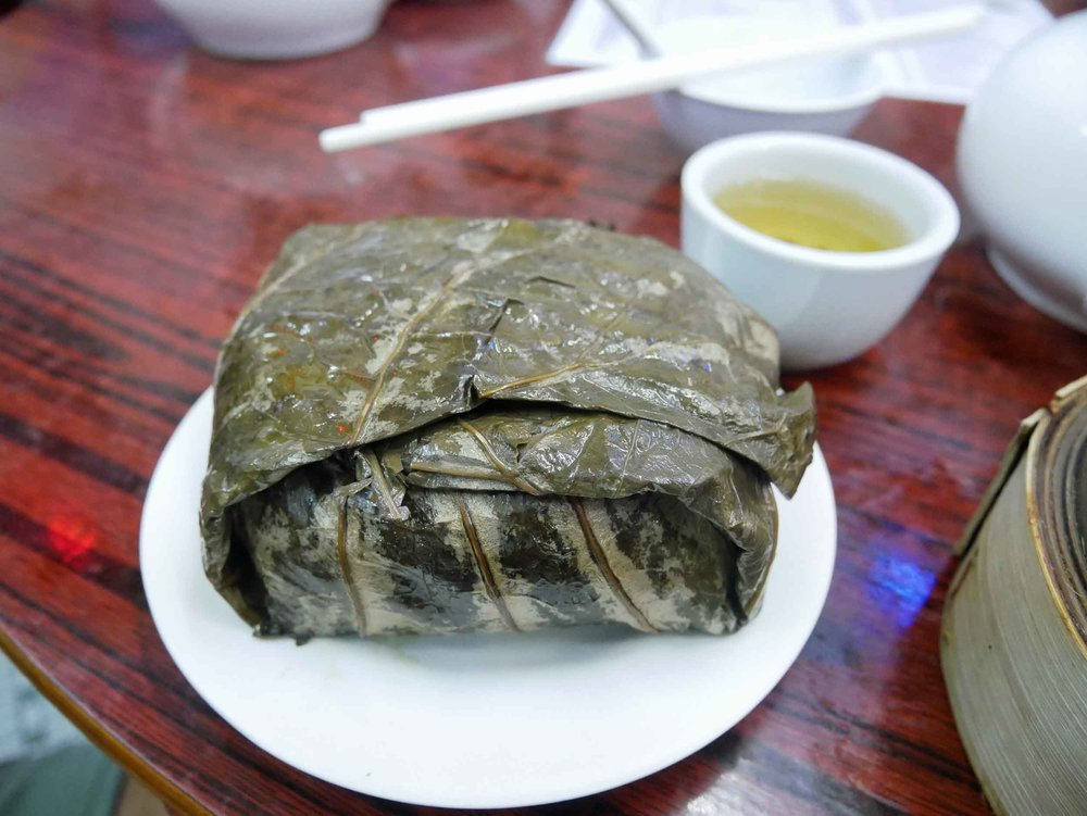 We also enjoyed the traditional  lo mai gai , which comes wrapped up in steamed lotus leaves.