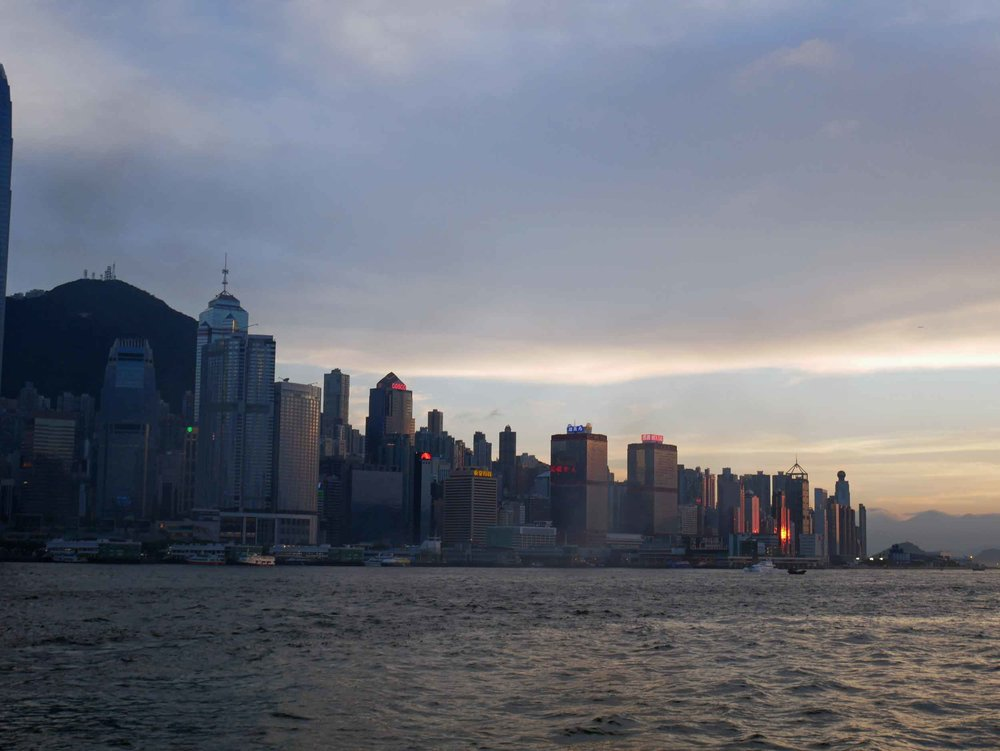 The sun setting on Hong Kong as we crossed the water to Kowloon.