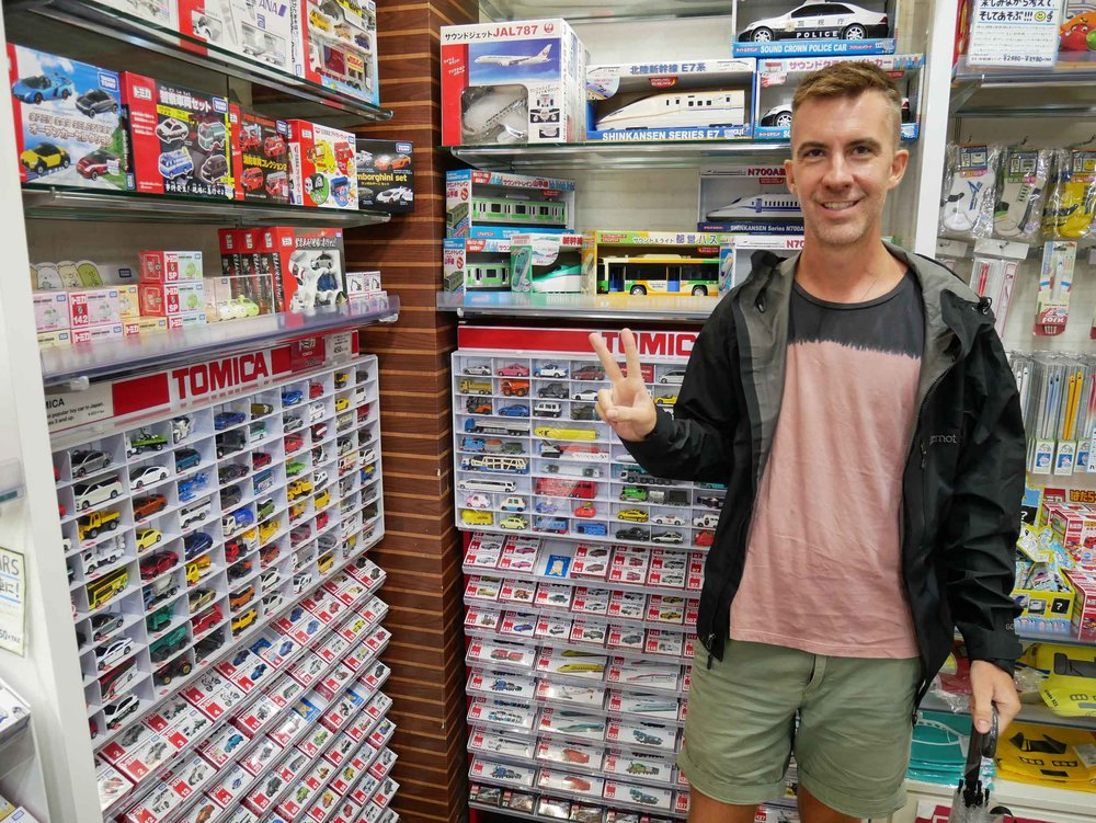 Trey geeks out over all the matchbox cars at giant Kiddy Land toy store.