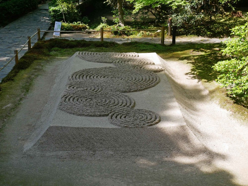 In awe of the impressive, raked gardens of the lovely, secluded Honen-in temple.