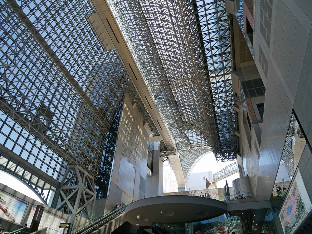 Looking up at the modern Kanazawa train station.