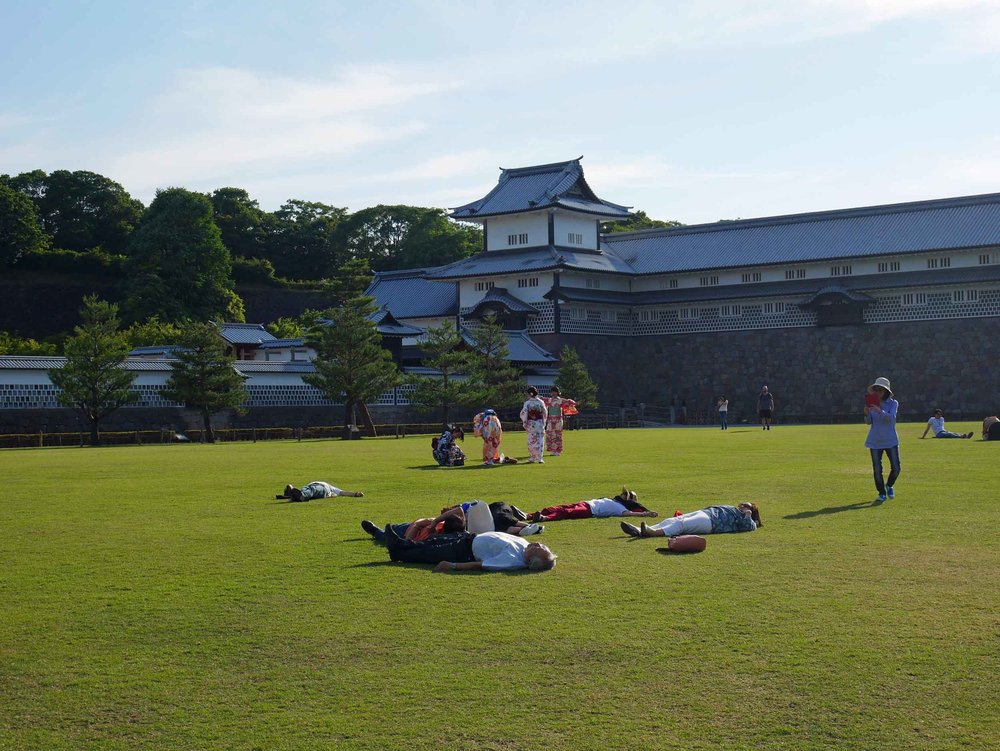 Lush lawn within Kanazawa Castle complex.