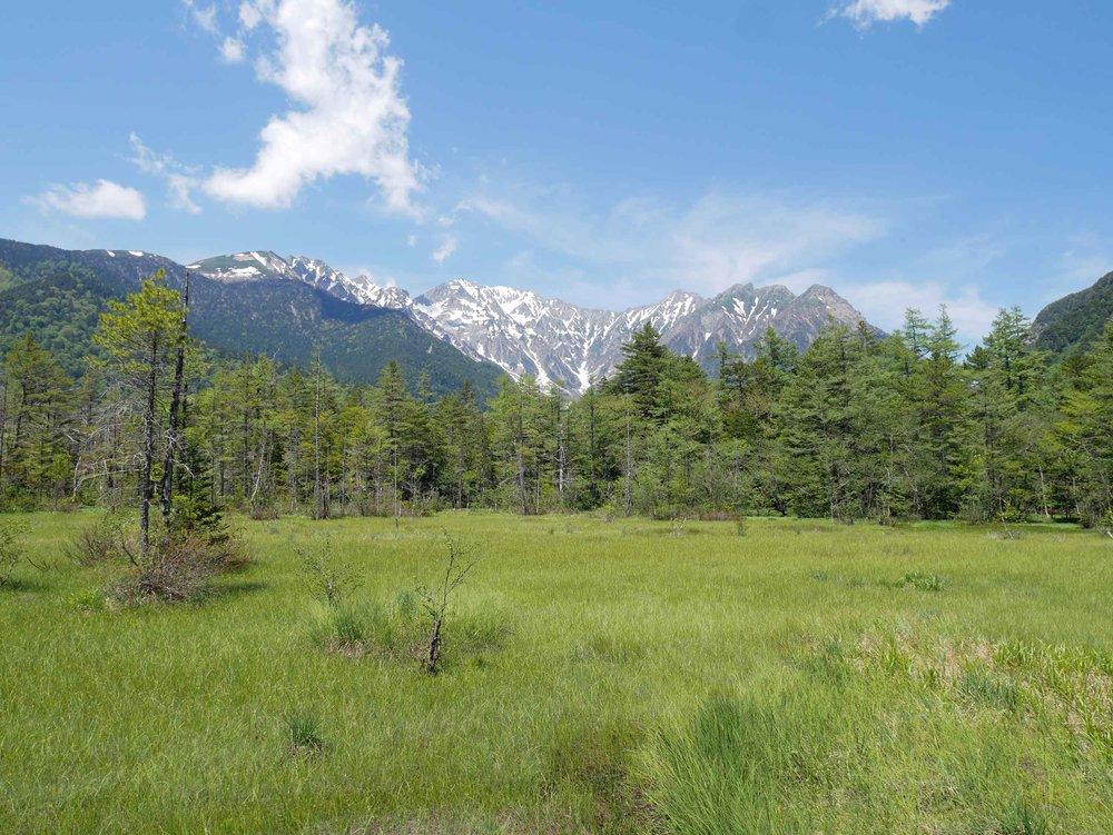 Enjoying the stunning vistas of the remote mountainous highland valley within the Hida Mountains range.