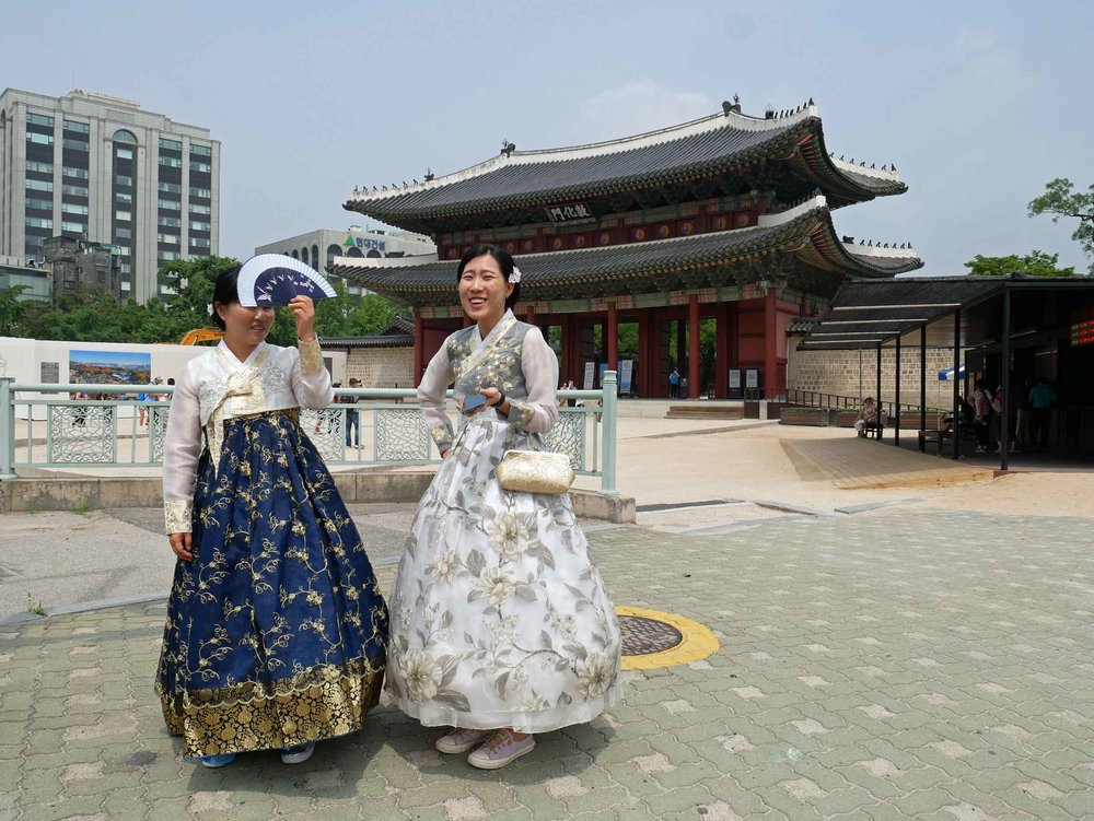 We adored the beautiful traditional costumes worn by women at the major tourist sites.
