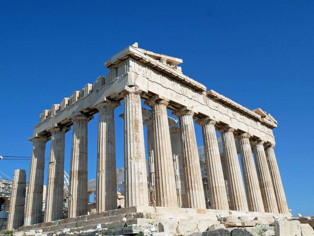 Work began on the Parthenon in 447 BC to replace an existing temple which was destroyed by the Persians in 480 BC.  The work began under the orders of Pericles to show the wealth and exuberance of Athenian power.