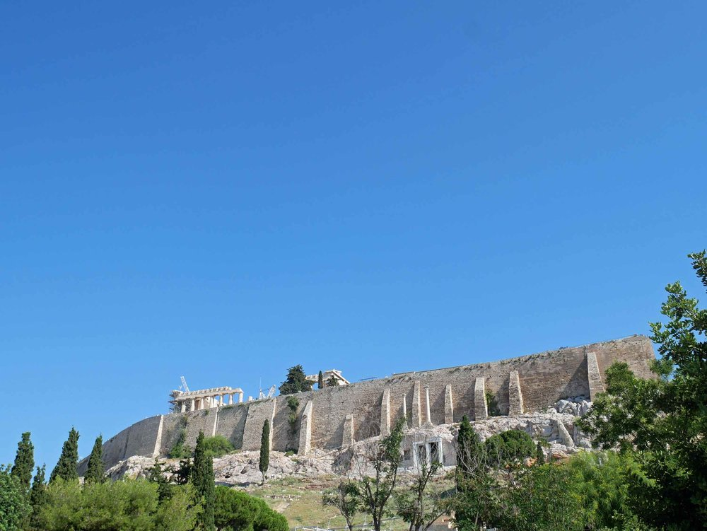 The Acropolis is located on a flat-topped rock that rises 150 m (490 ft) above sea level with a surface area of about 3 hectares (7.4 acres).