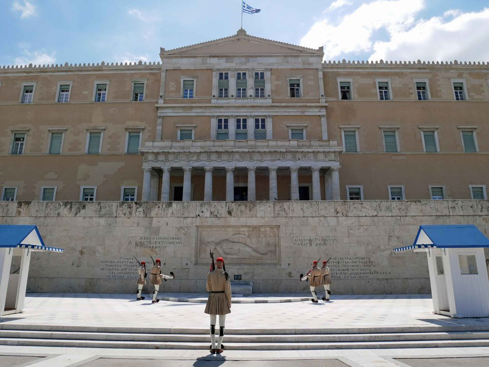 The Changing of the Guard takes place in front of the Hellenic Parliament and Presidential Mansion.  The Evzones, or guards, have become symbols of bravery and courage for the Greek people; they also happen to be literal giants.